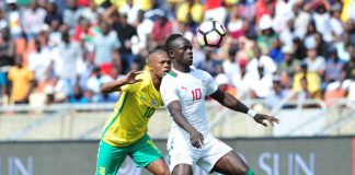Sadio Mane of Senegal challenged by Thulani Serero of South Africa during 2018 World Cup Qualifiers