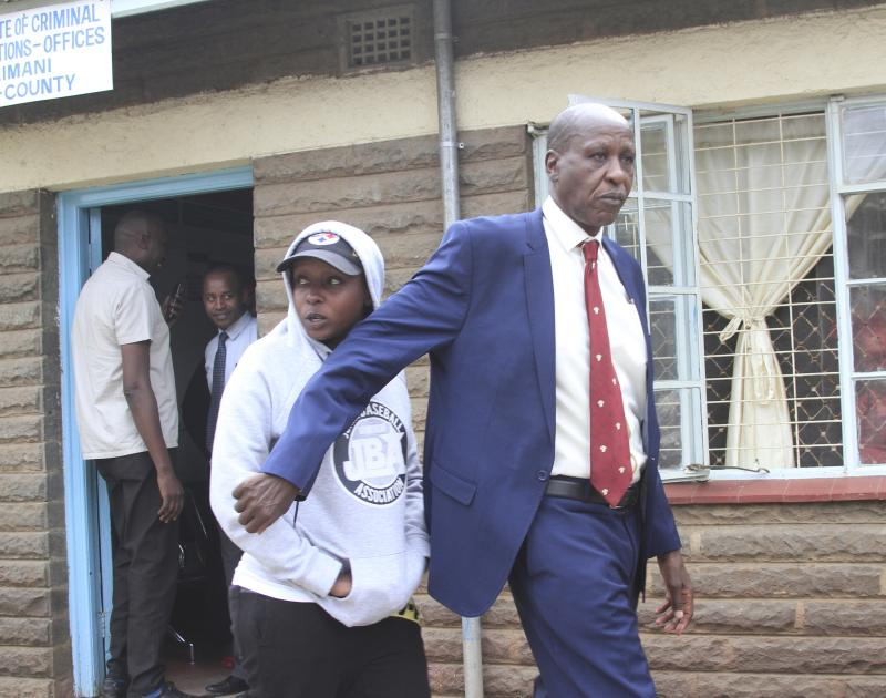 Television Journalist Jacque Maribe is escorted by her father out of Kilimani Police Station on September 27 2018