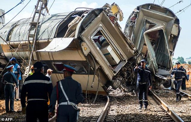 Moroccan rescue teams work through the wreckage of a train crash north of Rabat on October 16, 2018 (Picture by AFP)