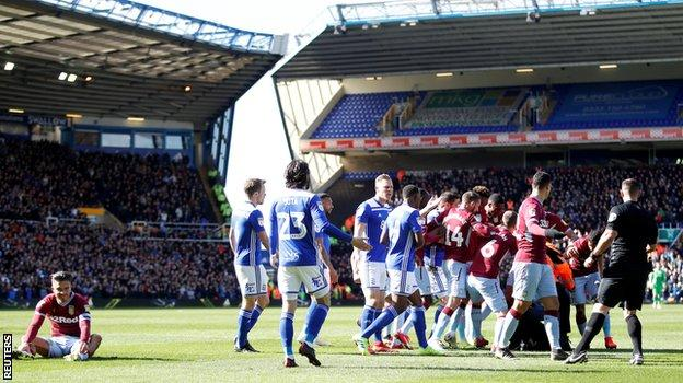 Grealish sat on the turf while Mitchell was apprehended