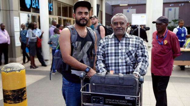 Ahmed Khalid pictured with his father at Nairobi Airport