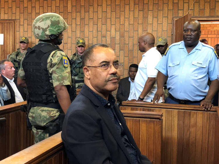 FILE PHOTO: Mozambique's former finance minister Manuel Chang appears in court during an extradition hearing in Johannesburg, South Africa, January 8, 2019. REUTERS/Shafiek Tassiem/File Photo