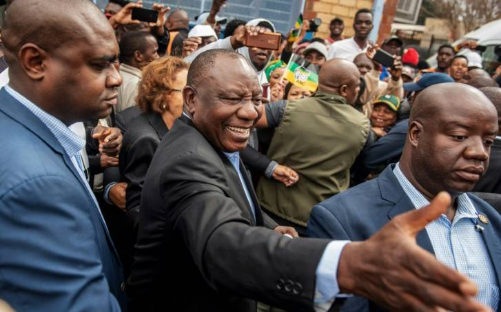 South African President Cyril Ramaphosa greeted voters before casting his ballot at a primary school in Soweto (Picture by AFP)