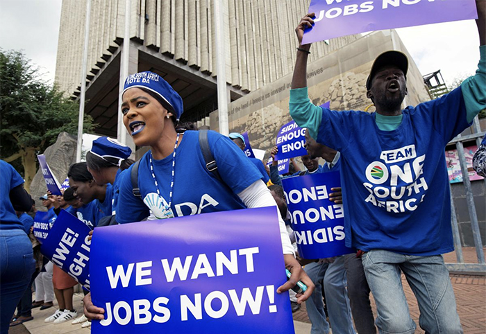 FILE PHOTO: Supporters of the Democratic Alliance picket demanding job opportunities ahead of the country's May 8 election in Pietermaritzburg, South Africa, April 17, 2019. REUTERS/Rogan Ward/File Photo