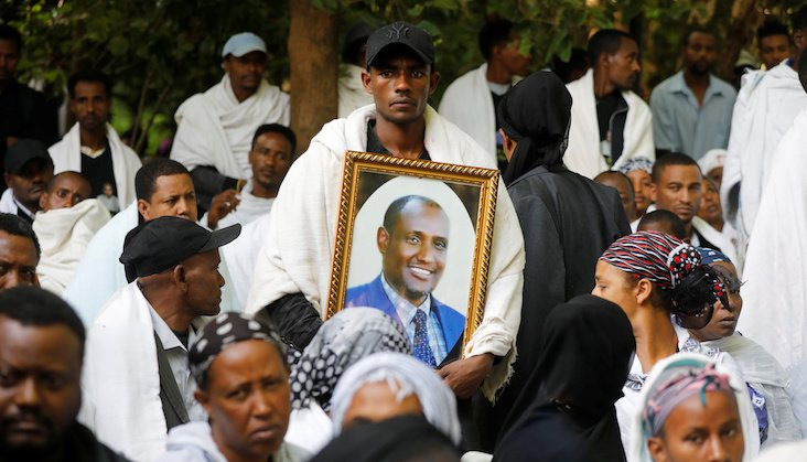 Mourners at the funeral on Wednesday of Amhara president Ambachew Mekonnen, who was killed in Saturday's attacks. REUTERS/Baz Ratner