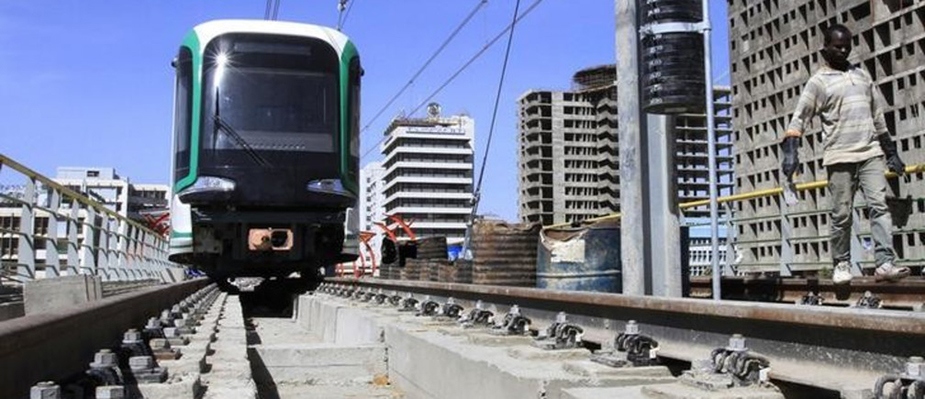 A labourer walks along a Metro-line construction in Ethiopia's capital Addis Ababa February 7